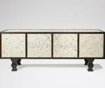 A pinewood sideboard veneered with a mosaic of white and gold earthenware