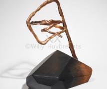 Lampe en bois, feuille d'or et bronze.