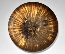 Mirror, a concave glass bowl with a lens out of the middle, brass mount