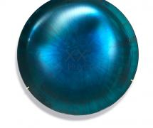 A turquoise-blue tinted concave mirror