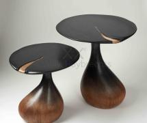 Two side tables with organic shapes in solid oak partially stained with ink