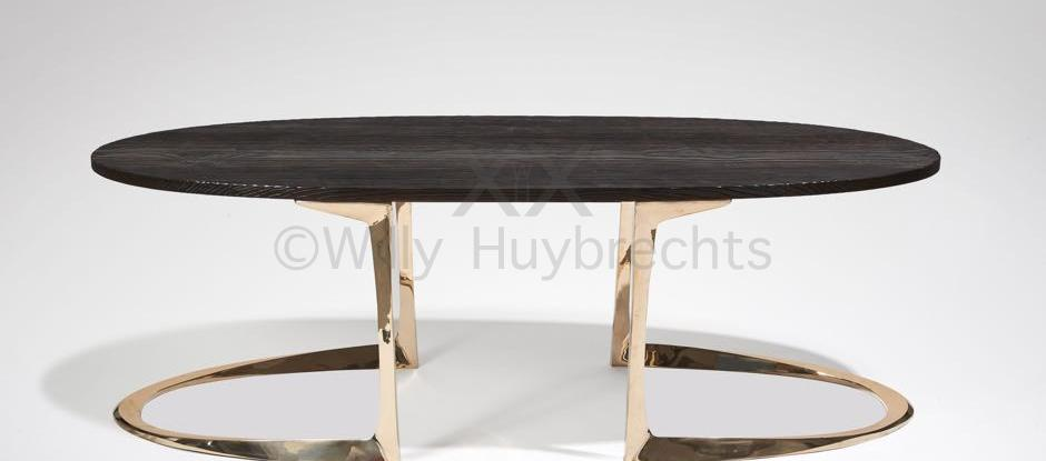 A polished and varnished bronze coffee table